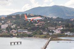 Corfu island, Greece. Modern passenger airplane landing at international airport. stock image