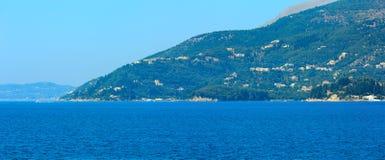 Corfu island Greece. Summer view of Corfu island Greece. Ionian sea coastline landscape. Two shots stitch high-resolution panorama Royalty Free Stock Photo