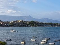 Corfu town on the Island of Corfu. The city of Corfu stands on the broad part of a peninsula, whose termination in the Venetian citadel is cut off from it by an Stock Photography