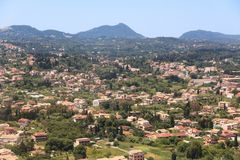 Greece residential area. Corfu Town (Kerkyra) in Greece. Residential district with cypress trees royalty free stock image