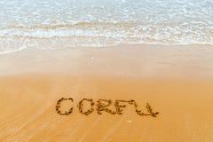 Corfu written on golden  beach, Corfu Royalty Free Stock Photo