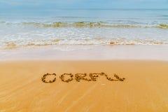 Corfu written on golden  beach, Corfu Royalty Free Stock Photos
