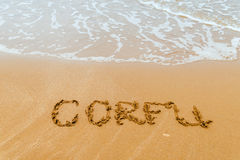 Corfu written on golden  beach, Corfu Stock Photo