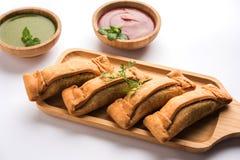 Coriandar OR Sambar vadi also known as kothimbir vada in Marathi. Served with Green chutney and tomato ketchup. selective focus Royalty Free Stock Photos