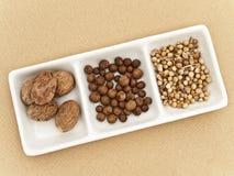 Coriander, black pepper seeds and nutmeg stock image