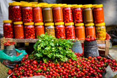 Coriander, chillis and jars Royalty Free Stock Photography