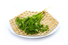 Coriander Coriandrum sativum on wickerwork dish Royalty Free Stock Photo