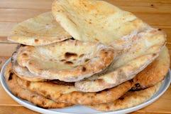 Coriander and garlic Naan bread. Royalty Free Stock Photo