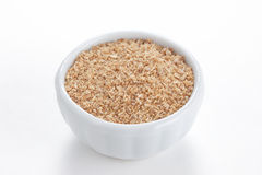 Coriander ground in a bowl on white background. Royalty Free Stock Images