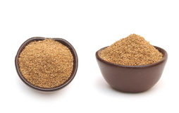 Coriander powder in a clay bowl Stock Photos