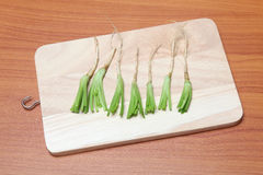 Coriander roots on the cutting board Stock Photo