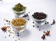 Coriander Seeds Black Pepper Fenugreek Leaves Dry. In Bowl isolated Coriander Seeds stock photos