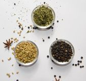 Coriander Seeds Black Pepper Fenugreek Leaves Dry. In Bowl isolated Coriander Seeds Royalty Free Stock Photo