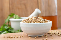 Coriander seeds in a bowl for add Flavor to Your Food on Choppin Royalty Free Stock Photos