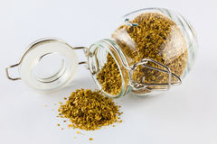 Coriander seeds in jar Royalty Free Stock Image