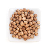 Coriander seeds in a white bowl royalty free stock image