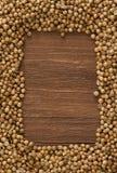 Coriander on wood. Coriander spices on wood background stock image