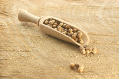 Coriander in a wooden shovel. On a timber board Stock Photo
