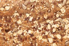 Coriandolo dei fiocchi e dei semi di sesamo dell'avena del pane. Fotografia Stock