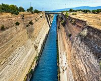 The Corinth Canal is a canal that connects the Gulf of Corinth with the Saronic Gulf in the Aegean Sea. It cuts through the narrow Isthmus of Corinth and royalty free stock photos