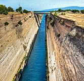 The Corinth Canal is a canal that connects the Gulf of Corinth with the Saronic Gulf in the Aegean Sea. It cuts through the narrow Isthmus of Corinth and stock photos