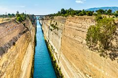 The Corinth Canal is a canal that connects the Gulf of Corinth with the Saronic Gulf in the Aegean Sea. It cuts through the narrow Isthmus of Corinth and royalty free stock photo