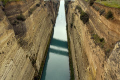 Corinth Canal in Greece. View of Corinth Canal in Greece, which cuts through the narrow Isthmus of Corinth and separates the Peloponnesian peninsula from the royalty free stock images