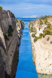 Corinth Canal in Greece. The Corinth Canal is a canal that connects the Gulf of Corinth with the Saronic Gulf in the Aegean Sea. It cuts Isthmus of Corinth and stock photos