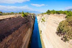 Corinth Canal in Greece. The Corinth Canal is a canal that connects the Gulf of Corinth with the Saronic Gulf in the Aegean Sea. It cuts Isthmus of Corinth and stock images