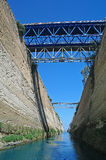 The Corinth Canal - view from sea level. The Corinth Canal and its bridge - view from sea level Stock Photos