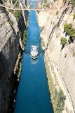 Corinth channel in Greece view on Aegean Sea while a ship is going to pass the channel.  Royalty Free Stock Photo