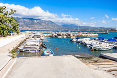 Corinth port in Greece. Boats and yachts in the Corinth harbor. Corinth is a city and former municipality in Corinthia in Peloponnese peninsula, Greece Stock Photography