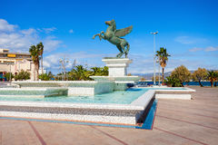 Corinth seafront in Greece. Fountain monument on Corinth seafront in the city center. Corinth is a city and former municipality in Corinthia in Peloponnese Stock Images