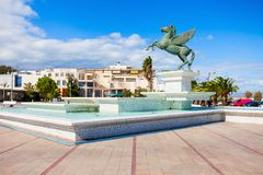 Corinth seafront in Greece. Fountain monument on Corinth seafront in the city center. Corinth is a city and former municipality in Corinthia in Peloponnese Stock Photo