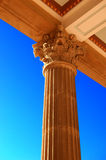 Corinthian Column. Ornate Corinthian column supports a beamed roof against a brilliant cerulean sky Royalty Free Stock Photos
