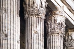 Corinthian columns of the ancient Adriano`s temple. The remains of the ancient Adriano`s temple in the front of Pietra`s square in Rome, Italy Royalty Free Stock Images