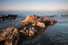 Coriscan rocks in sea at dusk Royalty Free Stock Image