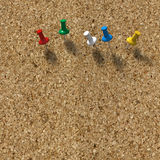 Cork background with 5 pushpins Stock Photography