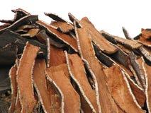 Cork bark pile. Huge pile of cork oak bark used in wine industry Stock Photo
