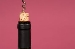 Cork being pulled out of wine bottle with a corkscrew Stock Photos