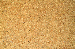 Cork Board. Close-up of a bulletin board featuring a cork board texture Royalty Free Stock Image
