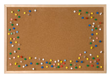 Cork board. With plenty of colorful pins Stock Photography
