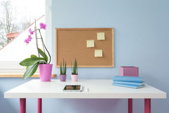 Cork board above desk Stock Photos