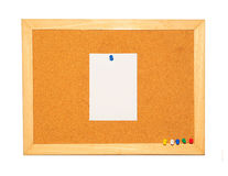 Cork Board with blank note and pin Stock Photo