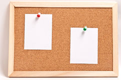Cork board with blank notes, isolated on white Stock Photos