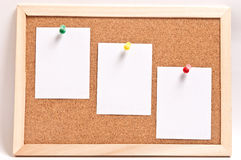 Cork board with blank notes, isolated on white Stock Photo