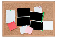 Cork board with blank photo prints and notes Royalty Free Stock Photos