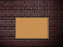 Cork board on brick wall Royalty Free Stock Photos