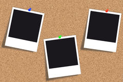 Cork board - Bulletin board - Pinboard. Bulletin board - Cork board with three empty photos and different colored thumbtacks Stock Images