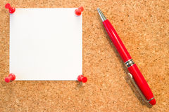 Cork board with clear white blank notice with the red pins and p. Cork board with clear white blank notice with the red pins royalty free stock images